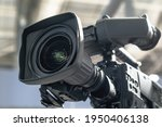 Professional camera. HDTV reportage camcorder, TV equipment service, large zoom lens. Event broadcast technologies, high tech