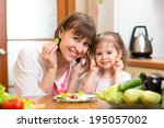 woman and daughter cooking and... | Shutterstock . vector #195057002