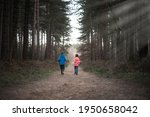Young Boy And Girl Walking...
