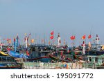 Постер, плакат: Fishing vessels casting anchor