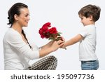 Young Kid Giving Bouquet Of Re...