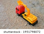 Tractor Toy In Sand On Beach....