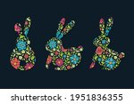 easter bunnies with flowers.... | Shutterstock .eps vector #1951836355