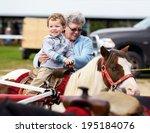 A Happy Boy Rides A Pony For...