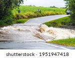 Flooded Road By An Overflowing...