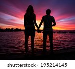 Stock photo little and big couple and the sunset 195214145