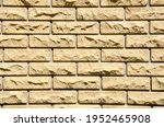 Close Up Beige Brick Wall With...