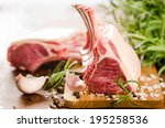 Small photo of Raw lamb chops with spices and herbs close-up on wooden background