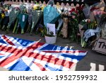 Small photo of London, England, UK - April 9, 2021: Laying of flowers tribute for Prince Philip, Duke of Edinburgh, at Buckingham Palace gate Credit: Loredana Sangiuliano