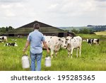 Farmer With Milk Churns In...