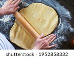 Hands  Rolling Pin And Dough...