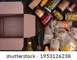 Volunteer With Box Of Food For...