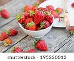 Ripe Red Strawberries On Woode...
