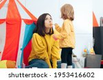 daughter play pretend feeding... | Shutterstock . vector #1953416602