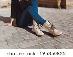 young girl posing in the street | Shutterstock . vector #195350825