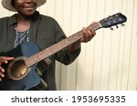A Black Person Playing Guitar...