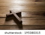 cross over  wood table with... | Shutterstock . vector #195380315