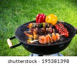 tasty skewers on the grill ... | Shutterstock . vector #195381398