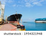 Rope Anchor With Cargo Ship...