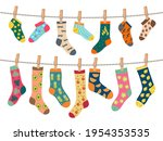 socks on rope. warm clothes... | Shutterstock .eps vector #1954353535