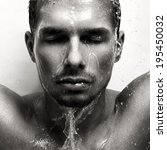 portrait of a man in the rain. | Shutterstock . vector #195450032