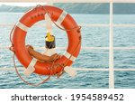 An Orange Lifebuoy Attached To...