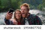 Happy Couple Taking Selfie On...