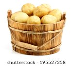 New Potatoes In A Wooden Bucke...