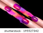 Nail Art. Fashionable fluor nails with drops of water with colorful crushed eyeshadow. Manicure and makeup concept. Closeup image isolated on black - stock photo