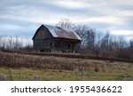 An Old Barn Standing In A Field ...