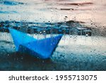 Paper Blue Boat Is Washed Up On ...