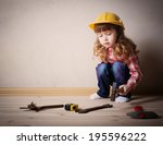 Little Girl Plays In The Builder