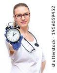 Female Doctor In White Coat He...