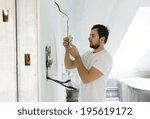 electrician installing light in ... | Shutterstock . vector #195619172