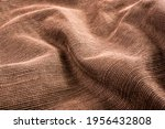 Small photo of clothing items washed cotton fabric texture with seams, clasps, buttons and rivets, macro, close-up