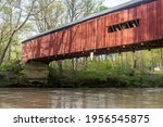 A Large  Red Wooden Bridge Sits ...