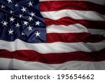 closeup of ruffled american flag | Shutterstock . vector #195654662