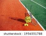 Tennis Ball Basket And A Racket ...