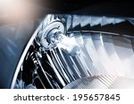 halogen light bulb H4 in headlight - stock photo