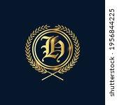 golden letter h laurel wreath... | Shutterstock .eps vector #1956844225