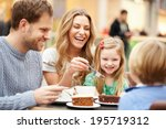 family enjoying snack in cafe... | Shutterstock . vector #195719312
