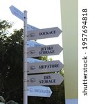 Small photo of Key Biscayne, FL, USA: April 2021: Rickenbacker marina arrows to give directions on different areas to get to. Arrows pointing to the dock, marina, jet skit storage, etc.