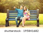 Young Couple In Love Sitting...