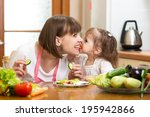 funny mother and kid eating... | Shutterstock . vector #195942866
