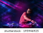 attractive young dj playing on... | Shutterstock . vector #195946925