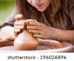 hands working on pottery wheel | Shutterstock . vector #196026896