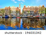 Stock photo canal houses of amsterdam at dusk with vibrant reflections netherlands 196031342