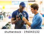 friendly hardware store worker... | Shutterstock . vector #196043132
