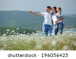 happy family having fun outdoors | Shutterstock . vector #196056425