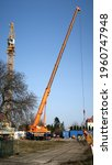 Small photo of Dresden, Germany, 02-23-2021, a big yellow car slewing crane at work in Dresden-Reick